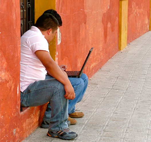 two men in Guatemala using a laptop