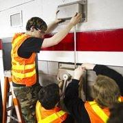 students repairing artwork