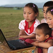 children in Mongolia and laptop