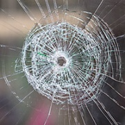 bullet hole in glass window