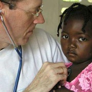 Dr. Paul Farmer with young Haitian patient