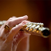 flute player with brass rat ring